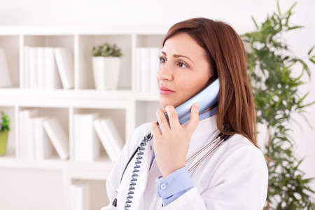 scheduling: Female doctor scheduling with phone