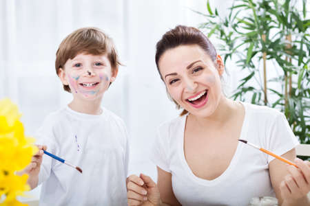 Smiling happy funny family moments with brashes and watercolors Imagens