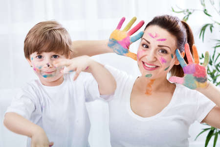 face paint: Smiling adorable family enjoy in colors at home Stock Photo