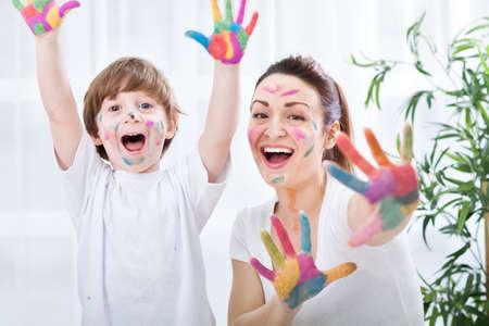 Child painting with mum Standard-Bild