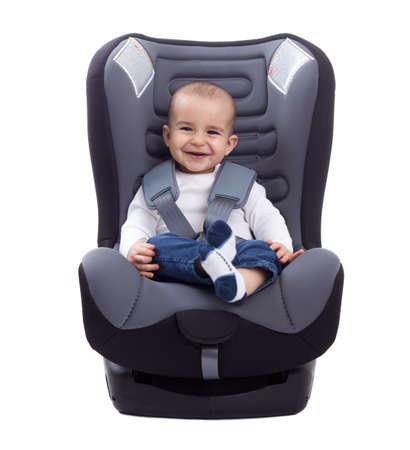 Smiling infant baby child sitting in a car seat, isolated on white