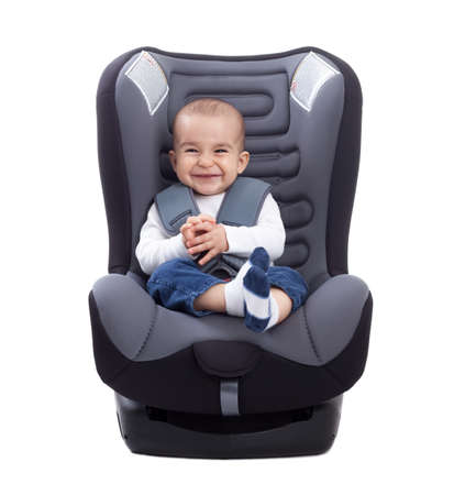Funny cute baby sitting in a car seat, isolated on white