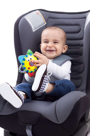 Baby boy sitting on child photo