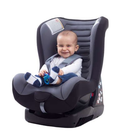 Smiling baby smiling and keep safe in car seat, siolated Stock Photo
