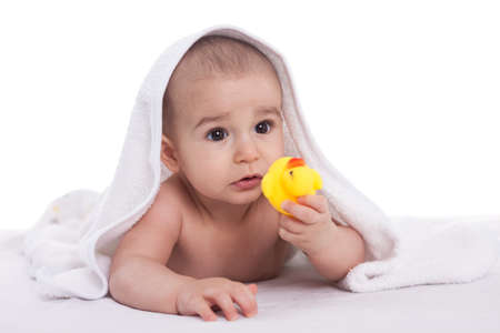 Baby with yellow duck isolated photo