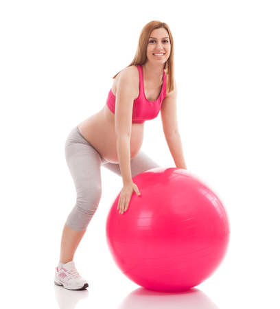 fruition: Pregnant woman exercise and limbering with ball isolated Stock Photo