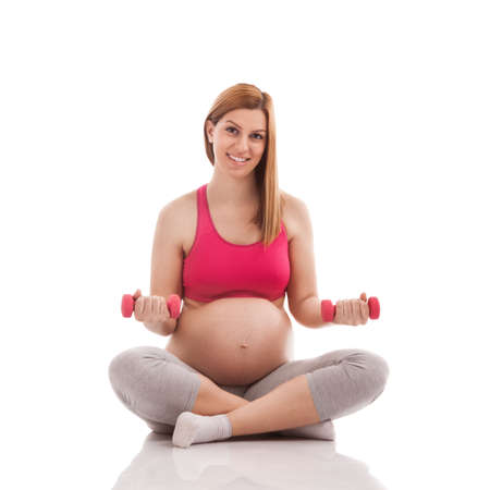 life giving birth: Fitness pregnant lady with dumbbells isolated