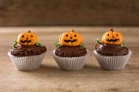Halloween cupcakes on wood background Stock Photo