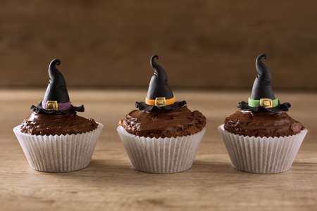 Halloween cupcakes with witch hat background Stock Photo