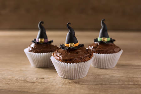witch: Three cupkaces with witch hat halloween holiday background