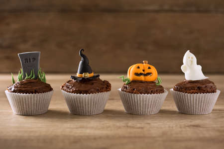 chocolate cakes: Halloween cupcakes on wood textured background