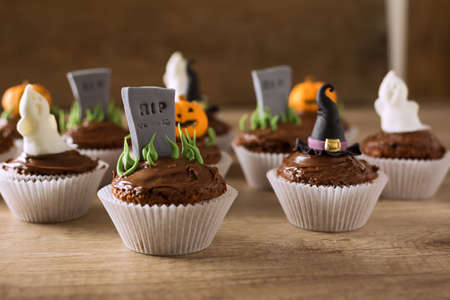 Group of helloween cupcakes on wood table background Stock Photo