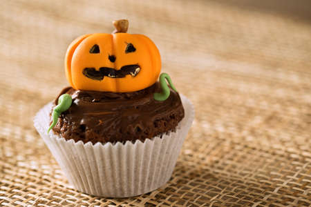 Cupcake pumpkin, happy halloween holiday