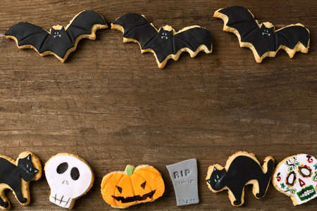fun background: Group of cookies for Halloween on wood background