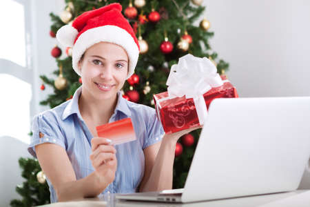 purchase: Beautiful woman making purchase online Stock Photo