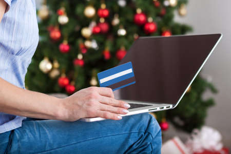online shopping: Woman shopping online with credit card for christmas holiday