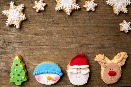 snow and trees: Festive cookies with snowflakes on retro background