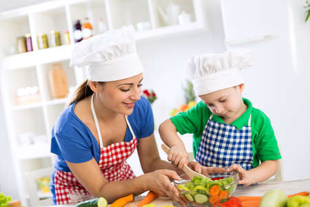 home cooking: Happy family make a lunch together at home Stock Photo