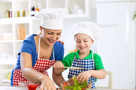 family together: Happy smiling family preparing healthy food  at home