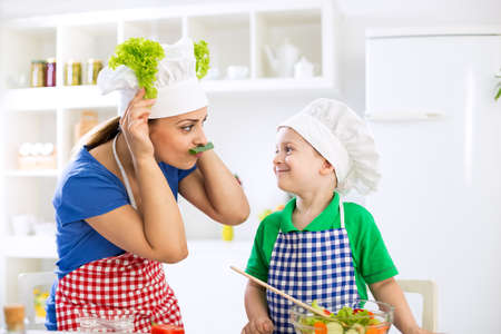 boy lady: Funny cute family moments in kitchen Stock Photo