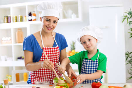 Mother and child cooking together with scoops