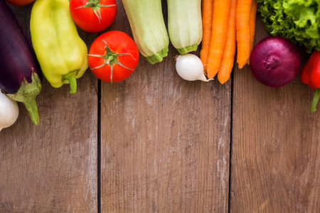Organic vegetables on wood background