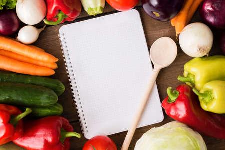 background summer: Vegetable recipe menu notes on wood background Stock Photo