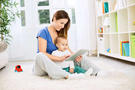 two generation family: Happy family using tablet for internet shopping Stock Photo