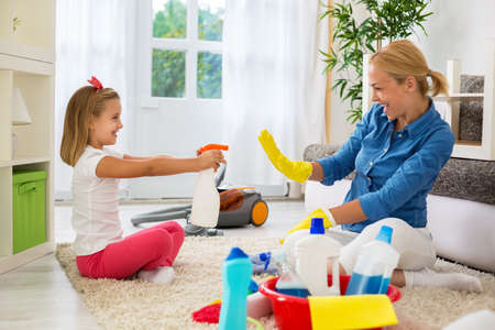family  room: Family cleaning room and having fun Stock Photo