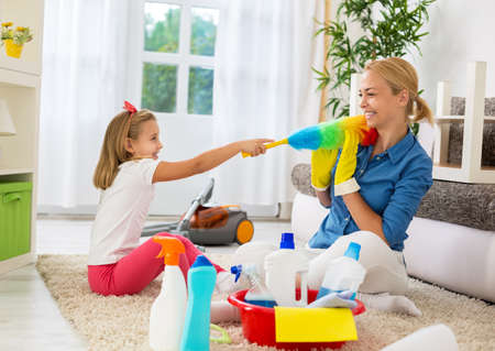 and activities: Happy family funny moments when cleaning home