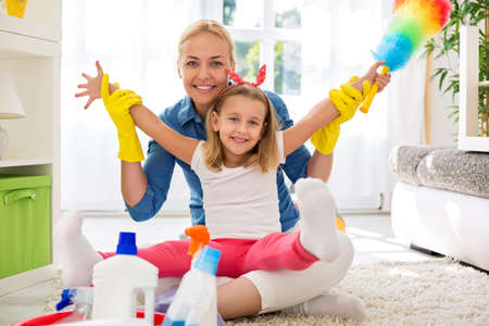 Mother and kid cleaning room together Imagens - 48062665