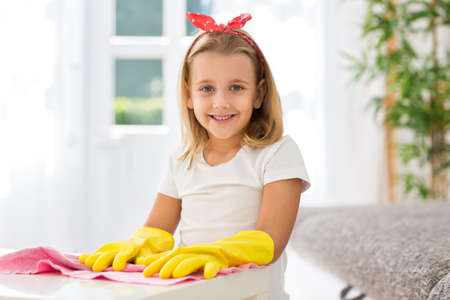 worth: Worth smiling young girl with gloves