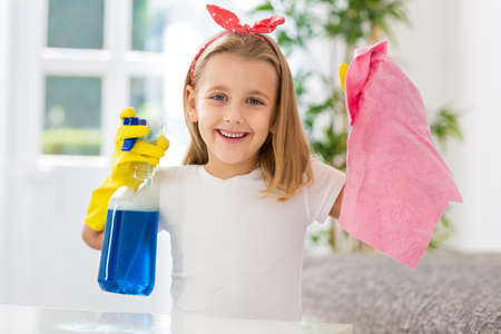 obligations: Happy smiling girl successful doing housework obligations Stock Photo
