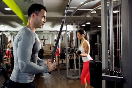 Muscular couple doing powerful exercise