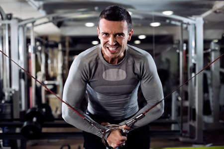 powerful man: Strong man during workout in the gym