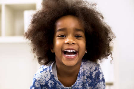 girl mouth open: Smiling beautiful african girl with healthy white teeth