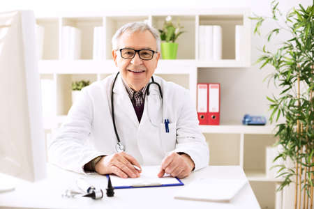 otologist: Specialist doctor otologist in office Stock Photo