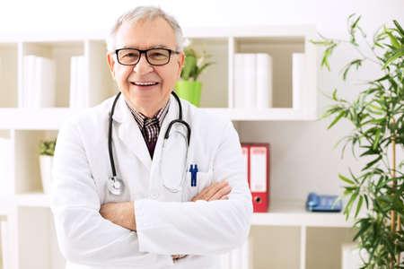 Smiling senior doctor with stethoscope in hospital Archivio Fotografico