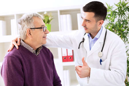 Happy old cured patient with success doctor specialist