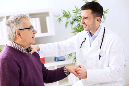 Doctor with patient in clinic office