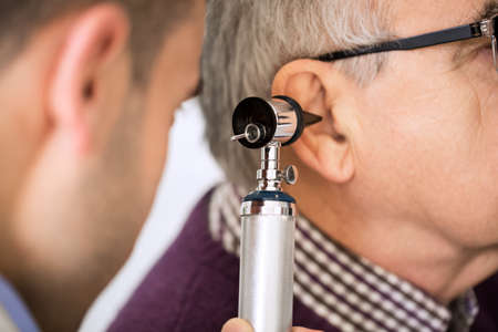 otologist: Doctor Examining old Patients Ear