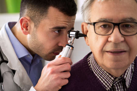 otologist: Doctor specialist Performs an Ear Examination