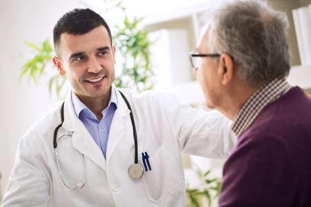 healthcare worker: Healthcare worker and elderly patient in hospital