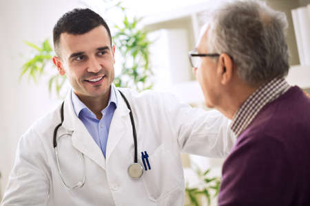 hospital patient: Healthcare worker and elderly patient in hospital