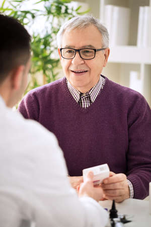 Medical doctor consulting senior patient about medicines