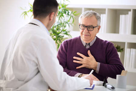 Sick old man visit doctor specialist about pains in breasts Imagens