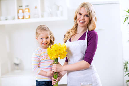 Beautiful girl giving bouquet flowers for mothers day