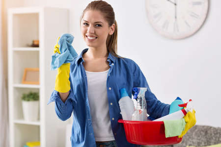 mopping: Smiling girl ready for cleaning, mopping time Stock Photo