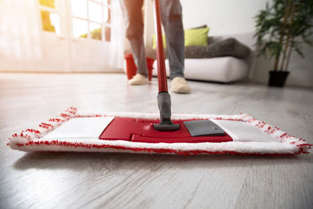 mopping: Mopping and cleaning room close up Stock Photo