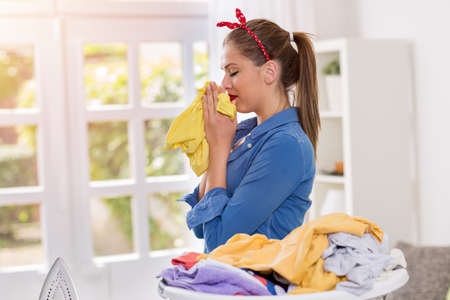 freshly: A young beautiful housewife smell of freshly washed clothes